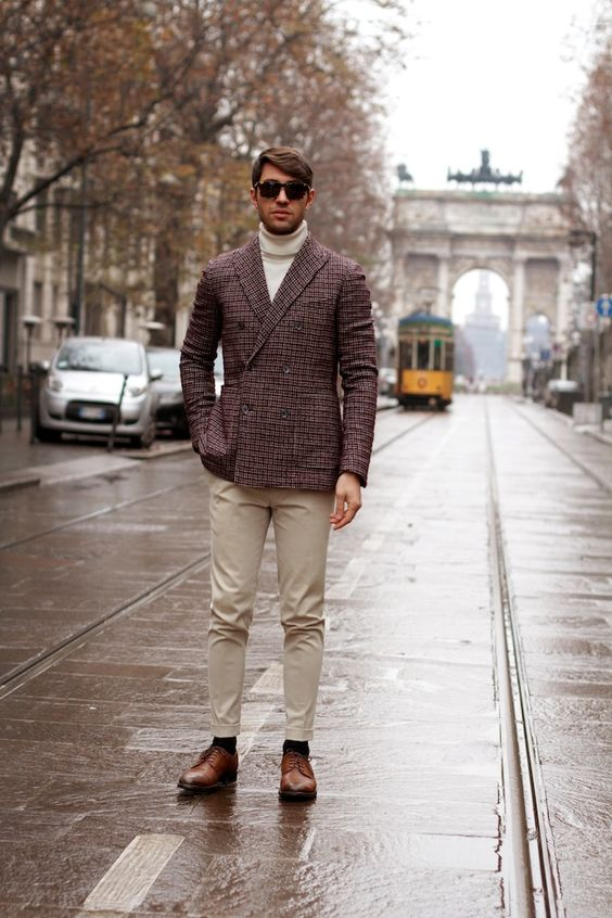 beige pants, a white turtleneck, a tweed jacket and cognac boots