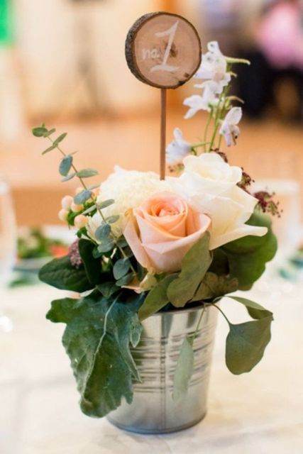Table number with roses and greenery