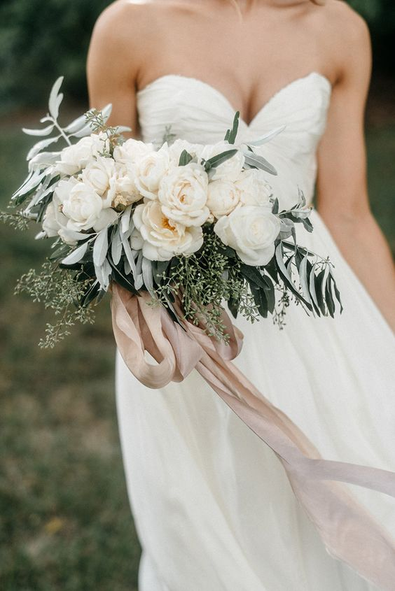 the softest bouquet of roses tied with hand dyed silk ribbon