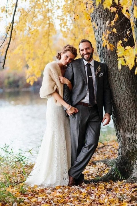 cream fur cover up for a cold fall wedding