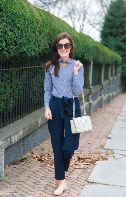With striped shirt, white bag and statement necklace
