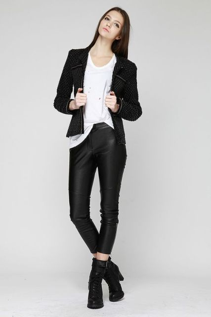 With white t-shirt, leather trousers and boots