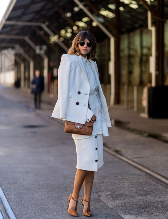all-white look with a button down skirt and tan heels and bag