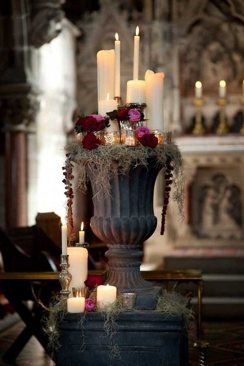 candles and flowers in a vintage urn