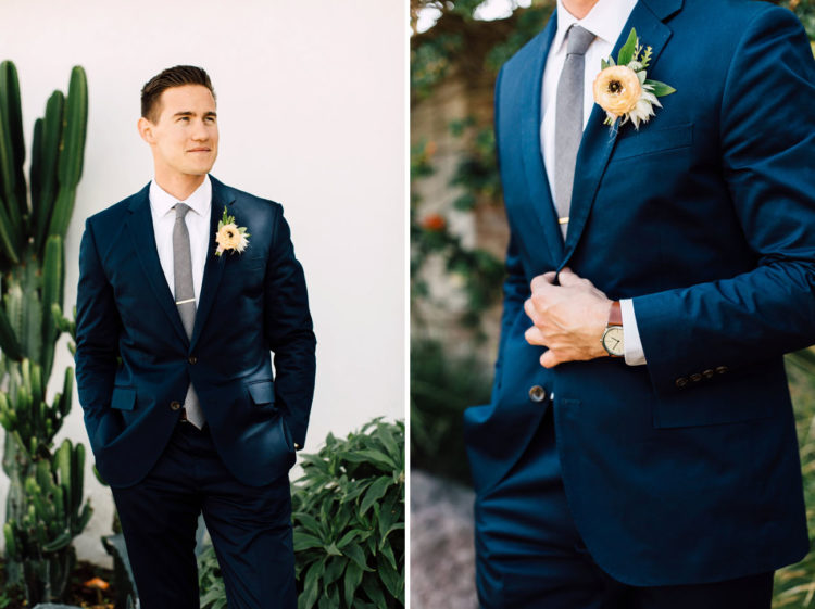 The groom was rocking a navy suit, colored suits are a hot trend