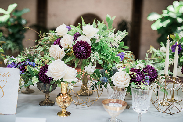 purple and white wedding centerpieces - photo by Jillian Rose Photography http://ruffledblog.com/romantic-wedding-ideas-with-pops-of-jewel-tones