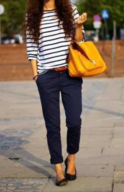 With loose striped shirt, black flats and orange bag