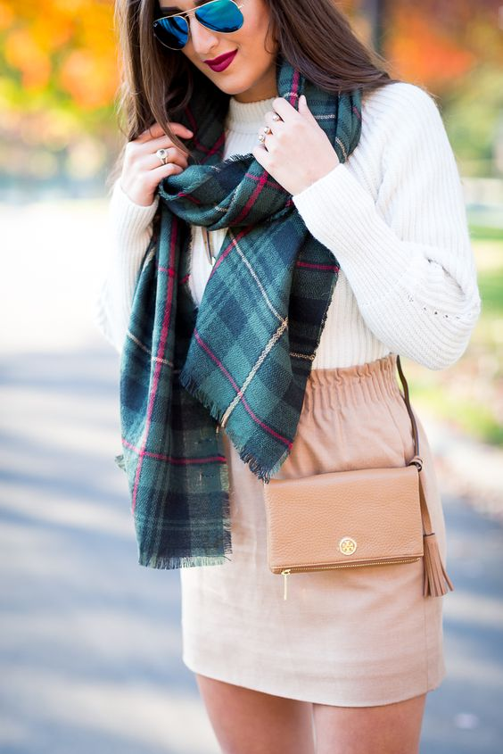 a plaid blanket scarf, a chunky knit sweater and a blush mini skirt