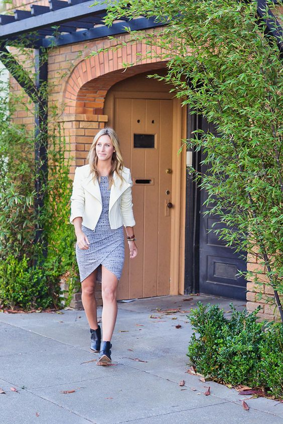 knit grey dress, a white jacket and ankle boots