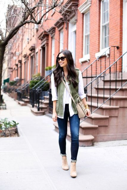 With cuffed skinny jeans, white blouse and neutral heels