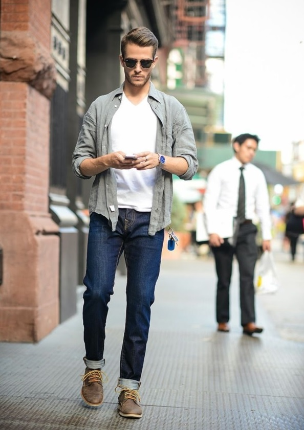 a white t-shirt, navy jeans, an olive grey shirt and brown shoes