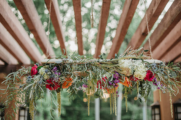 hanging floral arrangements - photo by L.A. Birdie Photography http://ruffledblog.com/colorful-summer-camp-wedding-editorial