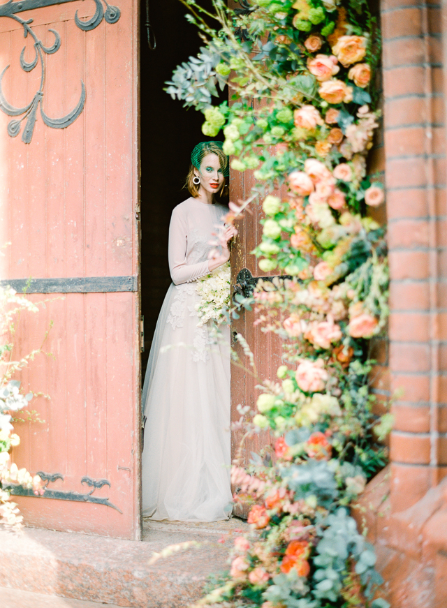 Flower arch in church | Kir & Ira Photography