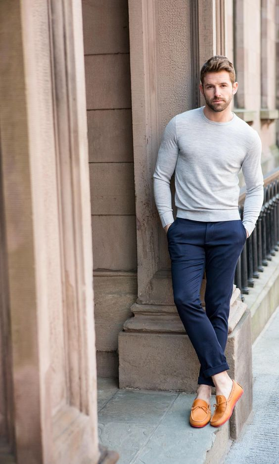 navy trousers, a light grey long sleeve and amber loafers