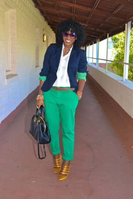 With white shirt, green pants and golden heels