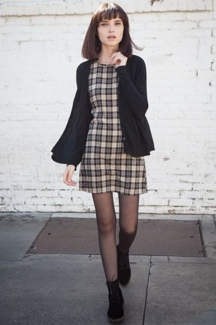 With black simple jacket and black flat boots