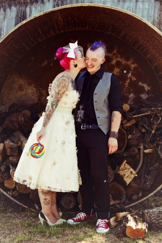 punk rock groom dressed in black with purple hair and red Converse