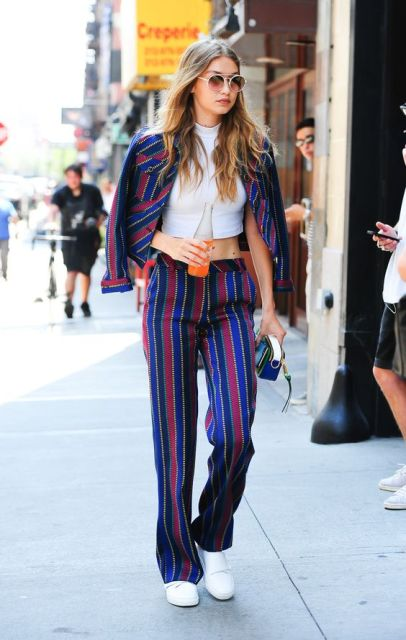 With striped jacket, white crop top and sneakers