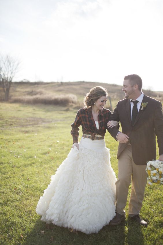 red plaid shirt over a gorgeous wedding gown