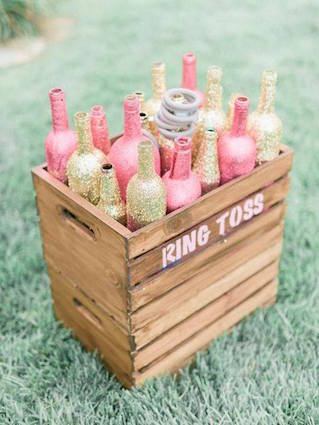 Ring toss DIY with glitter covered wine bottles