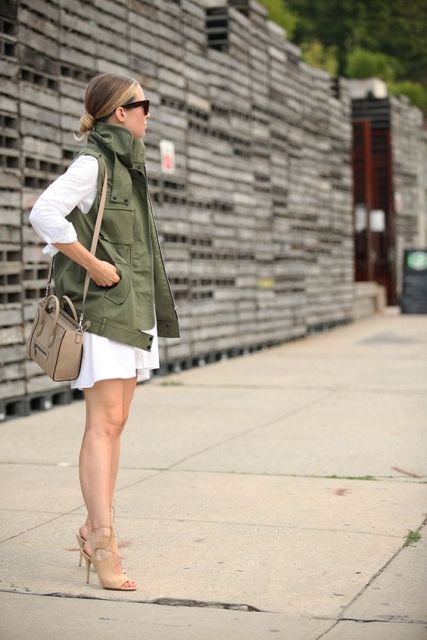 WIth white shirtdress and heels