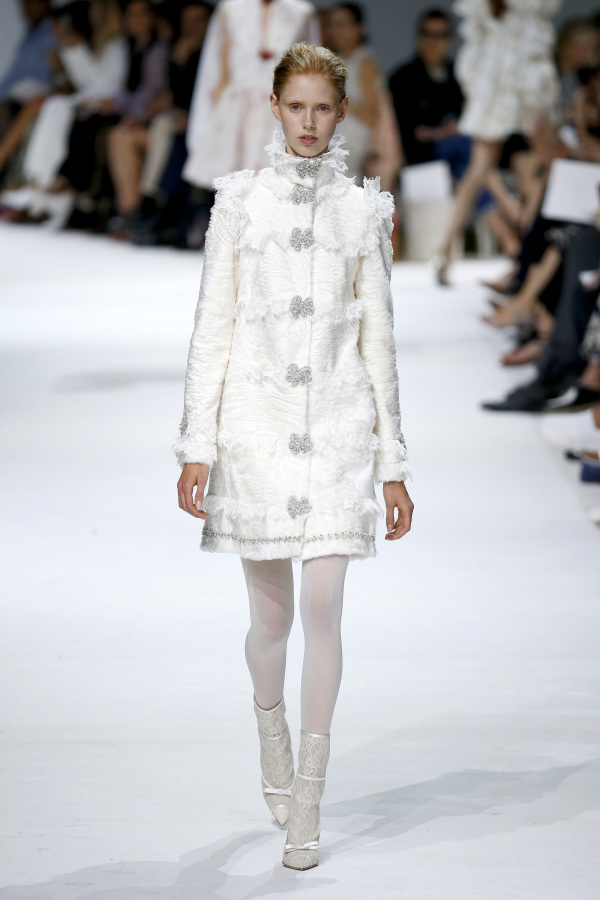 Giambattista Valli presented a white wedding coat-dress with silver detailing for outdoor ceremonies