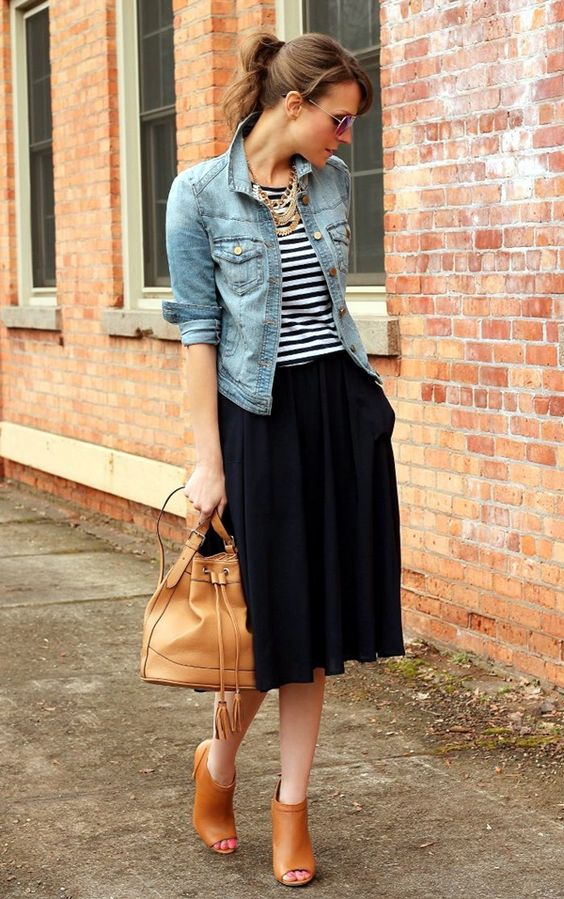 black skirt, a striped tee, brown cutout booties and a statement necklace
