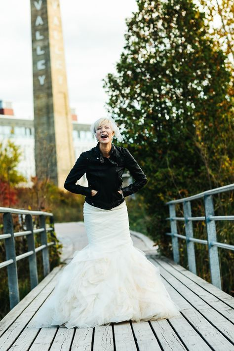 Vera Wang wedding gown with a short leather jacket