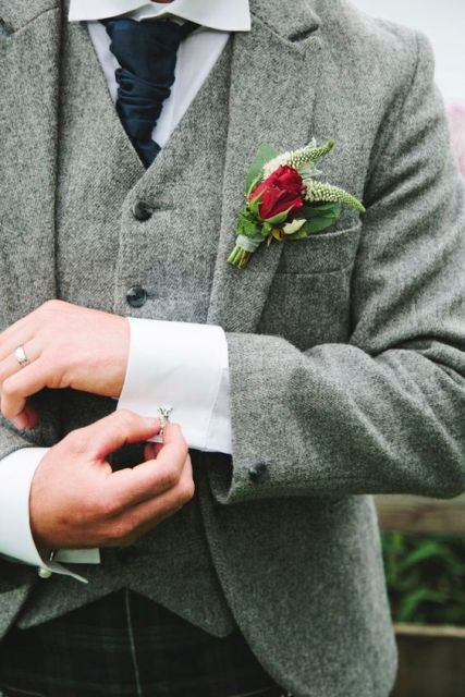 With tweed waistcoat, dark blue unique tie and red rose boutonniere