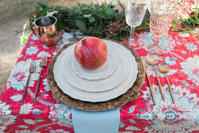 Pomegranate wedding place setting | Molly Lichten Photography