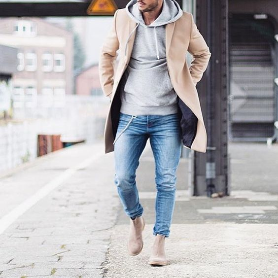 blue jeans, nude boots, a camel coat and a grey sweatshirt