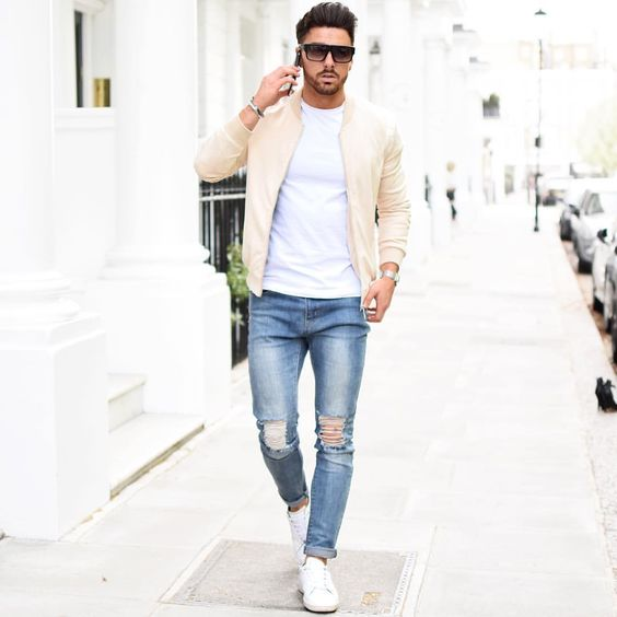 blue ripped jeans, a white tee, white chucks and a cream jacket