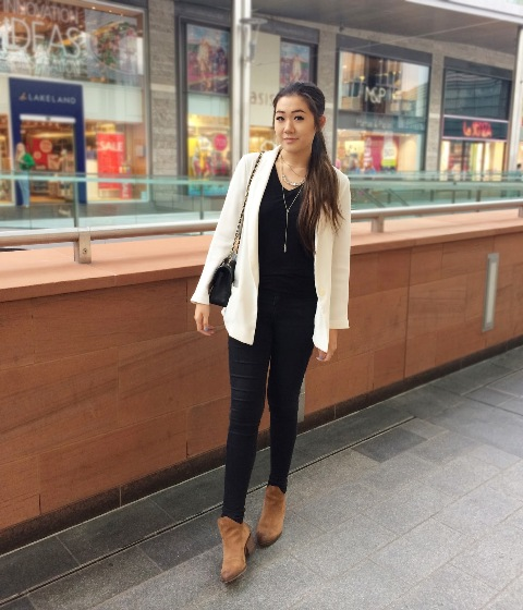 With black shirt, white jacket and black trousers