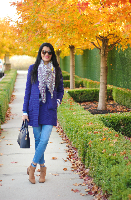 With coat, jeans and oversized scarf