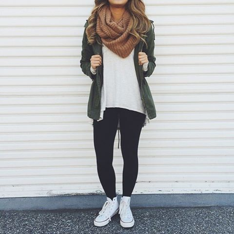 black leggings, a white t-shit, an love green jacket and white sneakers