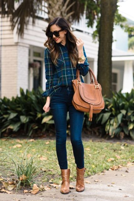 With plaid shirt, skinny jeans and brown bag