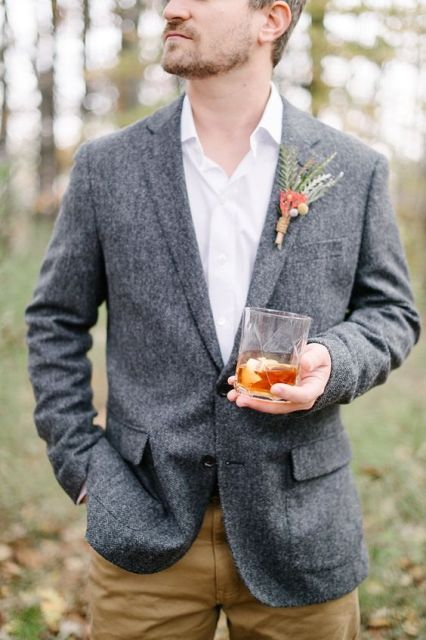 With white shirt, brown trousers and fall styled boutonniere