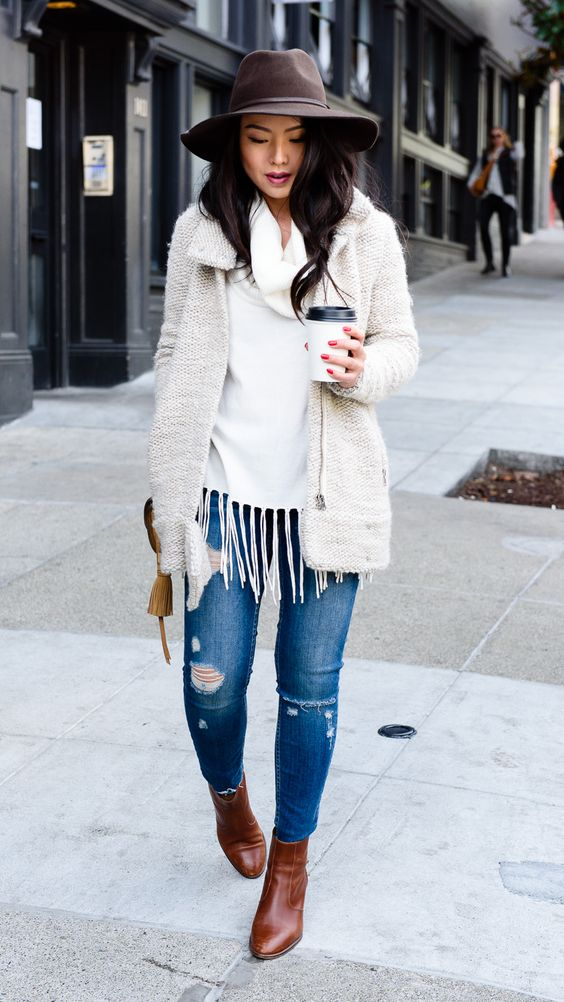 ripped jeans, a white turtleneck and a white tweed jacket