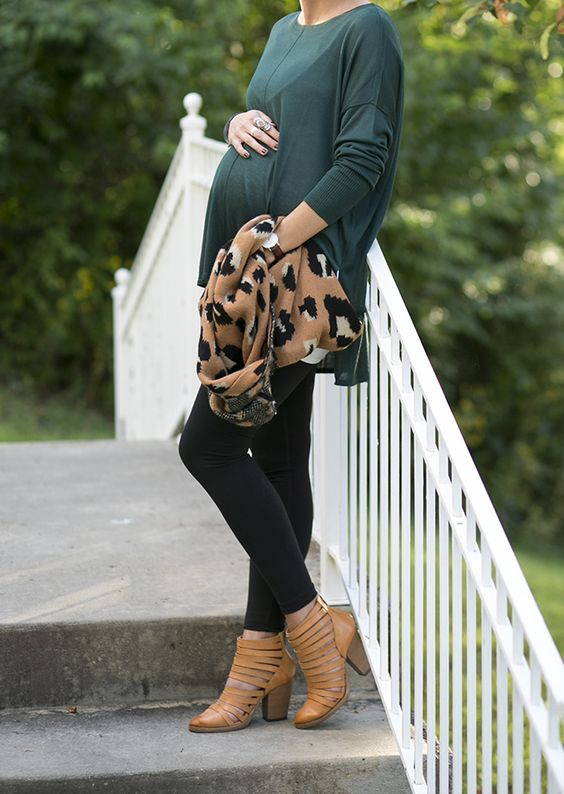 green swing dress, black leggings, ocher ankle boots and leopard