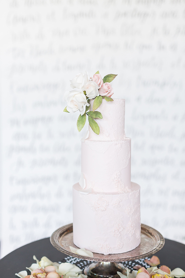 soft blush pink wedding cake - photo by Ryan & Alyssa Photography http://ruffledblog.com/french-couture-wedding-inspiration