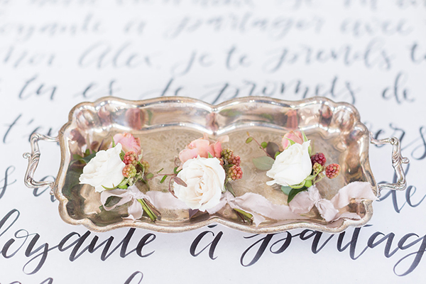 boutonnieres - photo by Ryan & Alyssa Photography http://ruffledblog.com/french-couture-wedding-inspiration