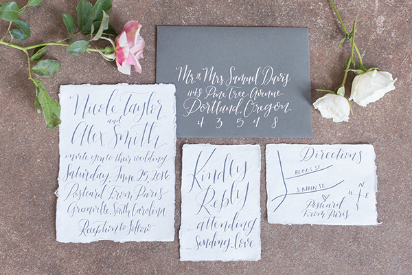 gray and white wedding invitations - photo by Ryan & Alyssa Photography http://ruffledblog.com/french-couture-wedding-inspiration