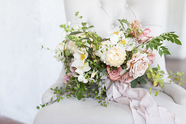 neutral wedding bouquet - photo by Ryan & Alyssa Photography http://ruffledblog.com/french-couture-wedding-inspiration