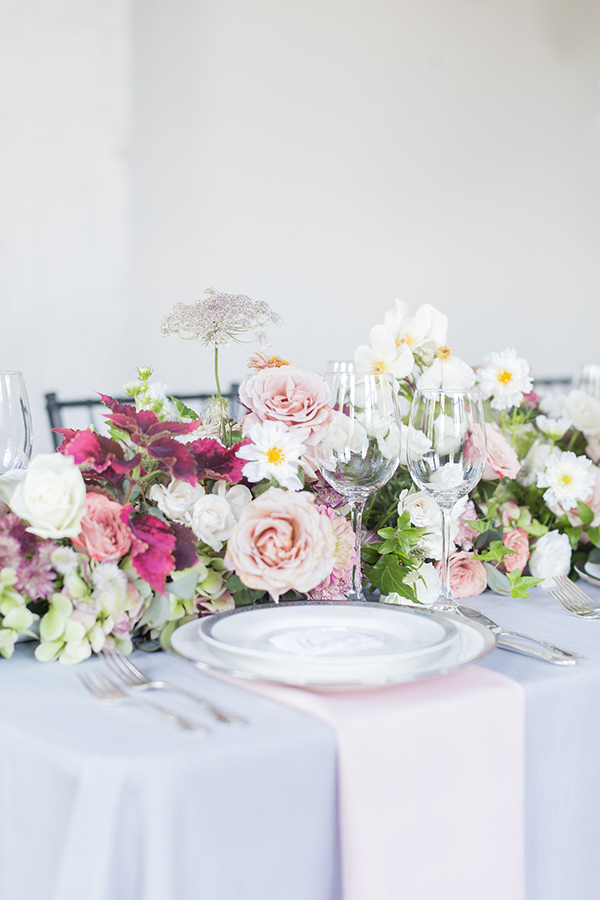pink wedding centerpieces - photo by Ryan & Alyssa Photography http://ruffledblog.com/french-couture-wedding-inspiration