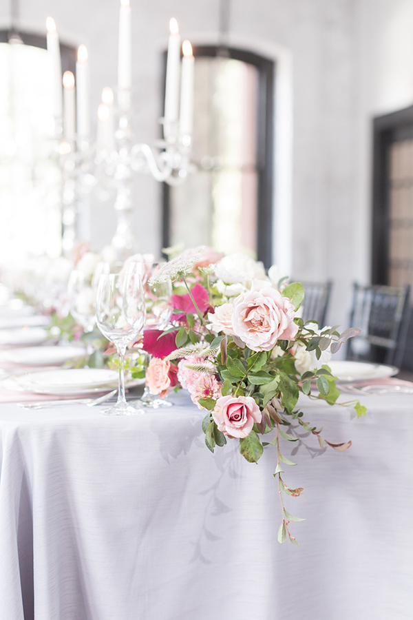 pink rose centerpieces - photo by Ryan & Alyssa Photography http://ruffledblog.com/french-couture-wedding-inspiration