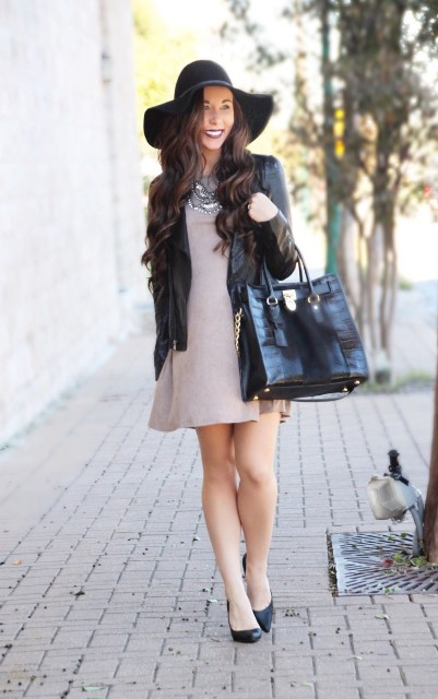 With black leather jacket, big bag and wide brim hat