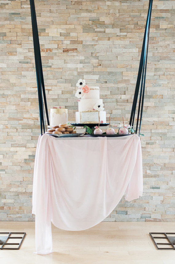The dessert table was hung, it was also done in blush and black