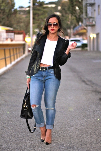 With white crop top, cuffed jeans and heels
