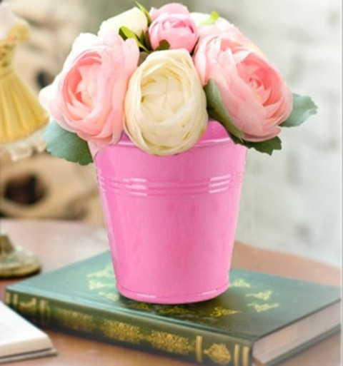 Bright pink bucket with yellow and pink roses