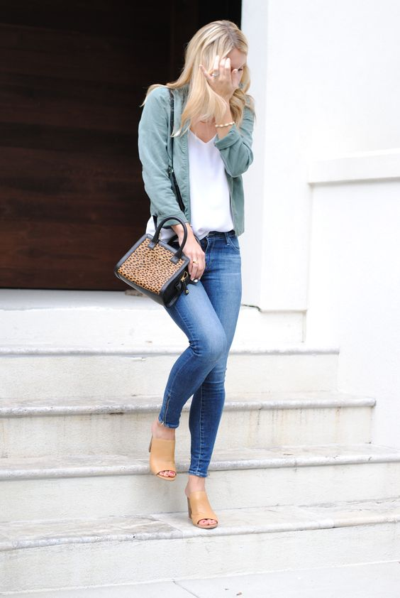 a moto jacket, jeans, nude mules